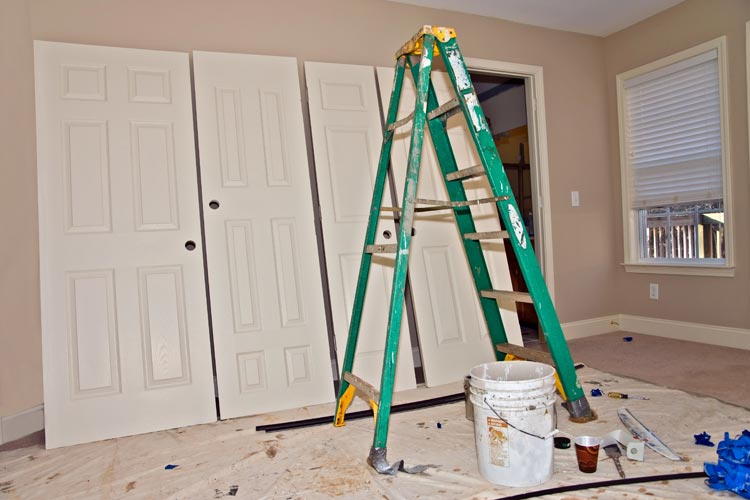 Photo of closet doors about to be installed
